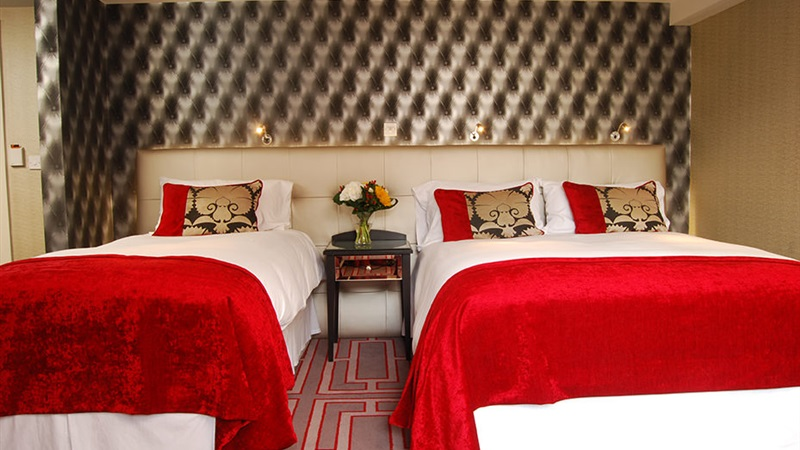 Deluxe Twin with luxurious feather-topped mattresses in Benedicts of Belfast