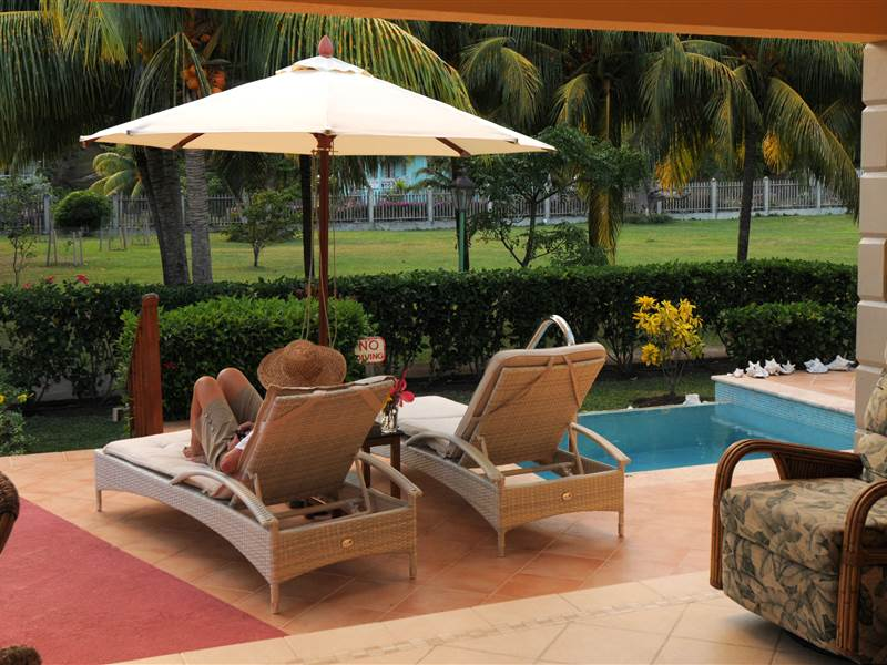 Sun Loungers Beside Pool