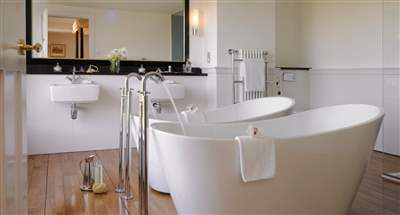 Twin Baths with Orchids