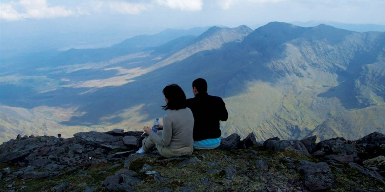 Couple on top of mountain