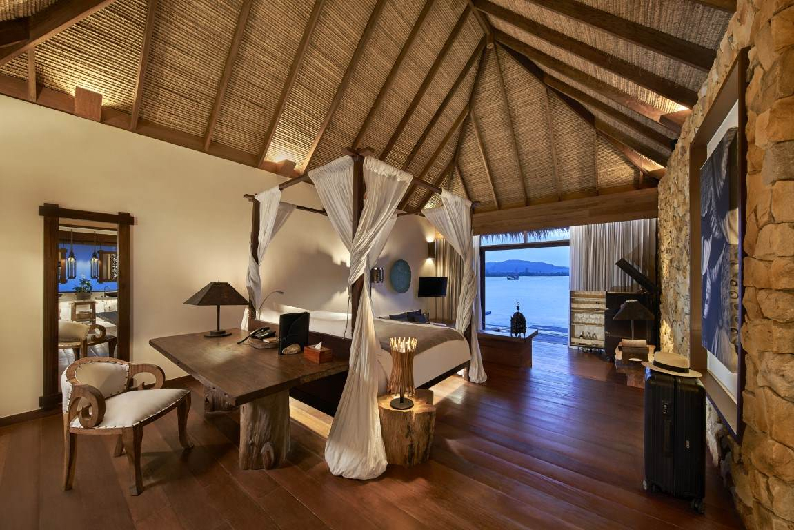 King-size bed in a one bedroom overwater villa