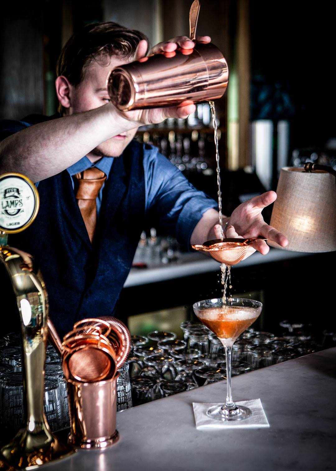 barman pouring cocktail