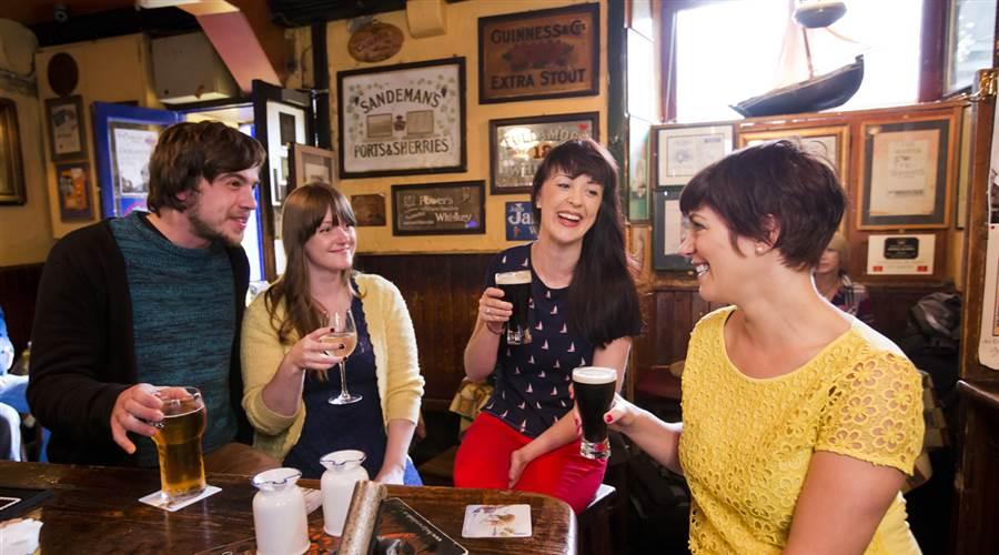 Friends enjoying drinks in Galway